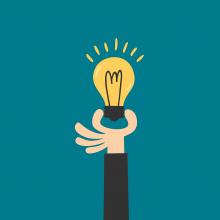 Illustration d'une main tenant une ampoule illuminée.